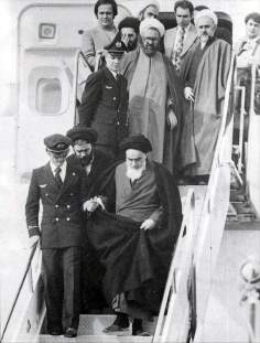 Imam Khomeini, his arrival to Iran on 22 of Bahman - victory of the Islamic Revolution, in the back Shahid Mutahhari can be see
