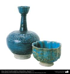 Blue pitcher and bowl with calligraphic relief - Islamic pottery - Iran twelfth century AD.