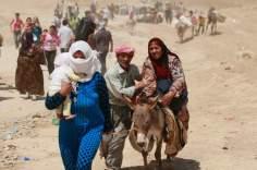 Réfugiés syriens se déplacent vers l'Irak