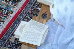 Muslim Woman reading daily supplications