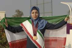 Спорт мусульманских женщин - Мусульманская дама , выграющая золотую медаль - 155