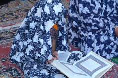 Little Girl learning the Holy Quran (Holy book of Muslims)