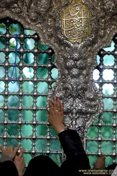 Shi'ah muslims express their love for Imam Reza, visiting his tomb