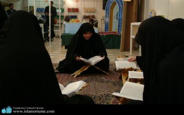 Muslim women studying the Holy Quran