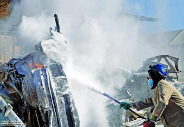 Lo hijab delle donne musulmane durante il lavoro-Pompiera
